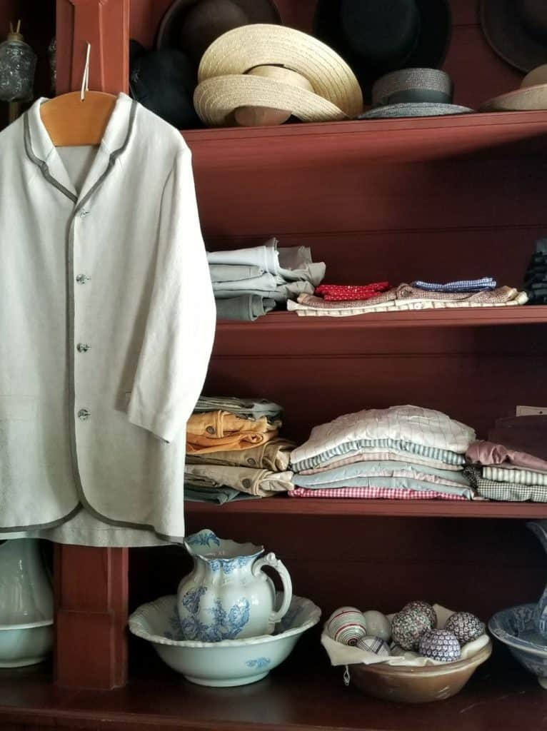 Historic general store with fabric and linens.  Clutter that is holding you back.